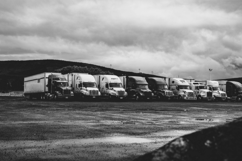 semi trucks parked at a rest stop